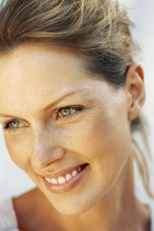 A smiling woman with a perfect smile, thanks to cosmetic bonding in Totowa NJ