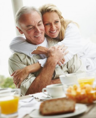 A loving elderly couple about to eat breakfast without pain because of dental implants in Totowa, NJ
