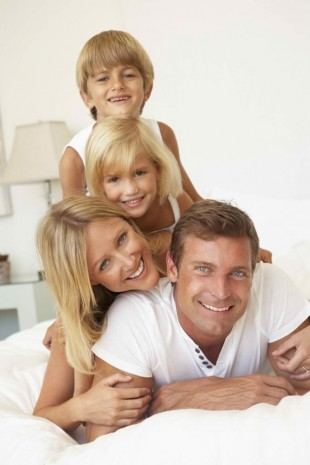 A happy, smiling family knowing they are protecting their smiles, thanks to dental sealants