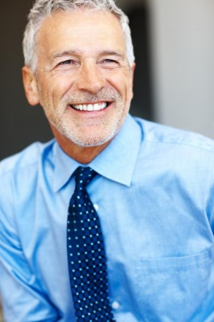 A smiling man with bright teeth, thanks to teeth whitening in Totowa NJ